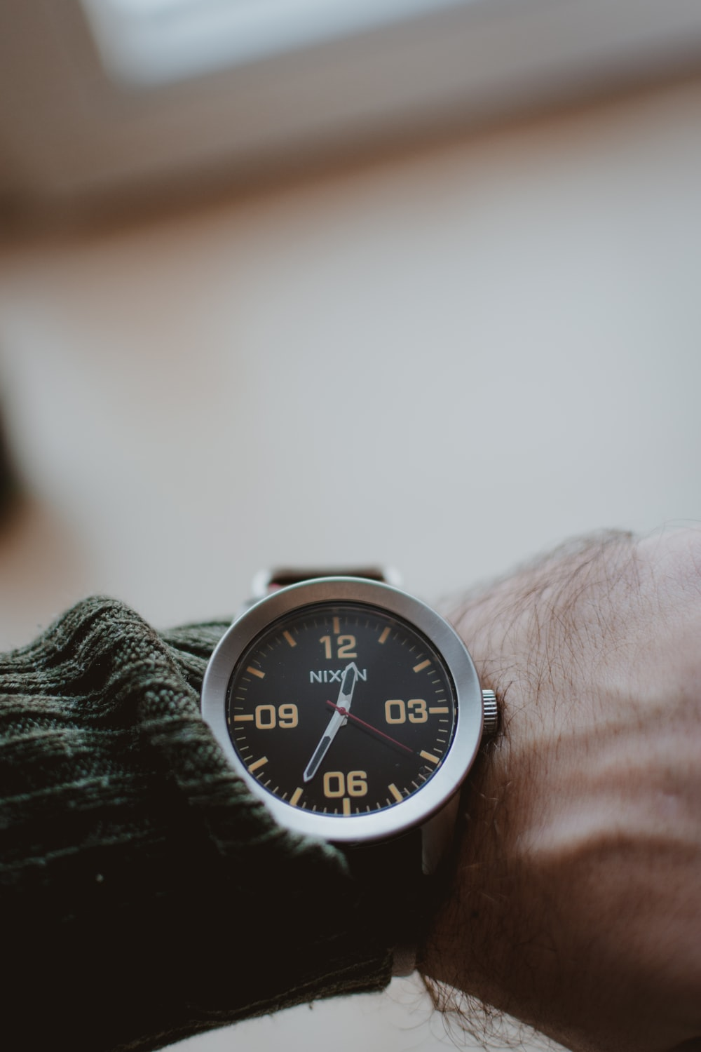 round black and silver-colored analog watch