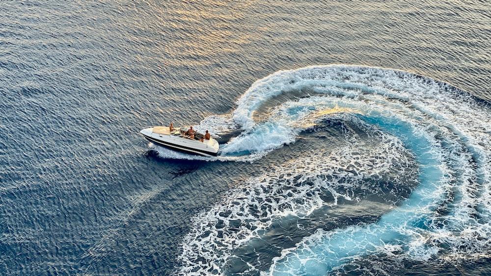 white yacht running on sea water