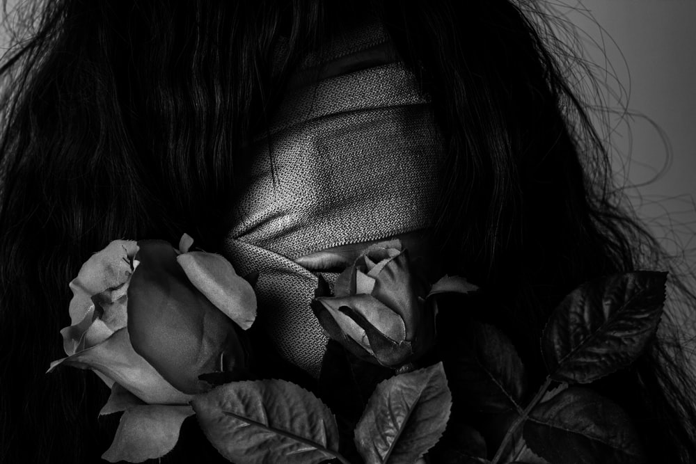 grayscale photography of woman covered by strap