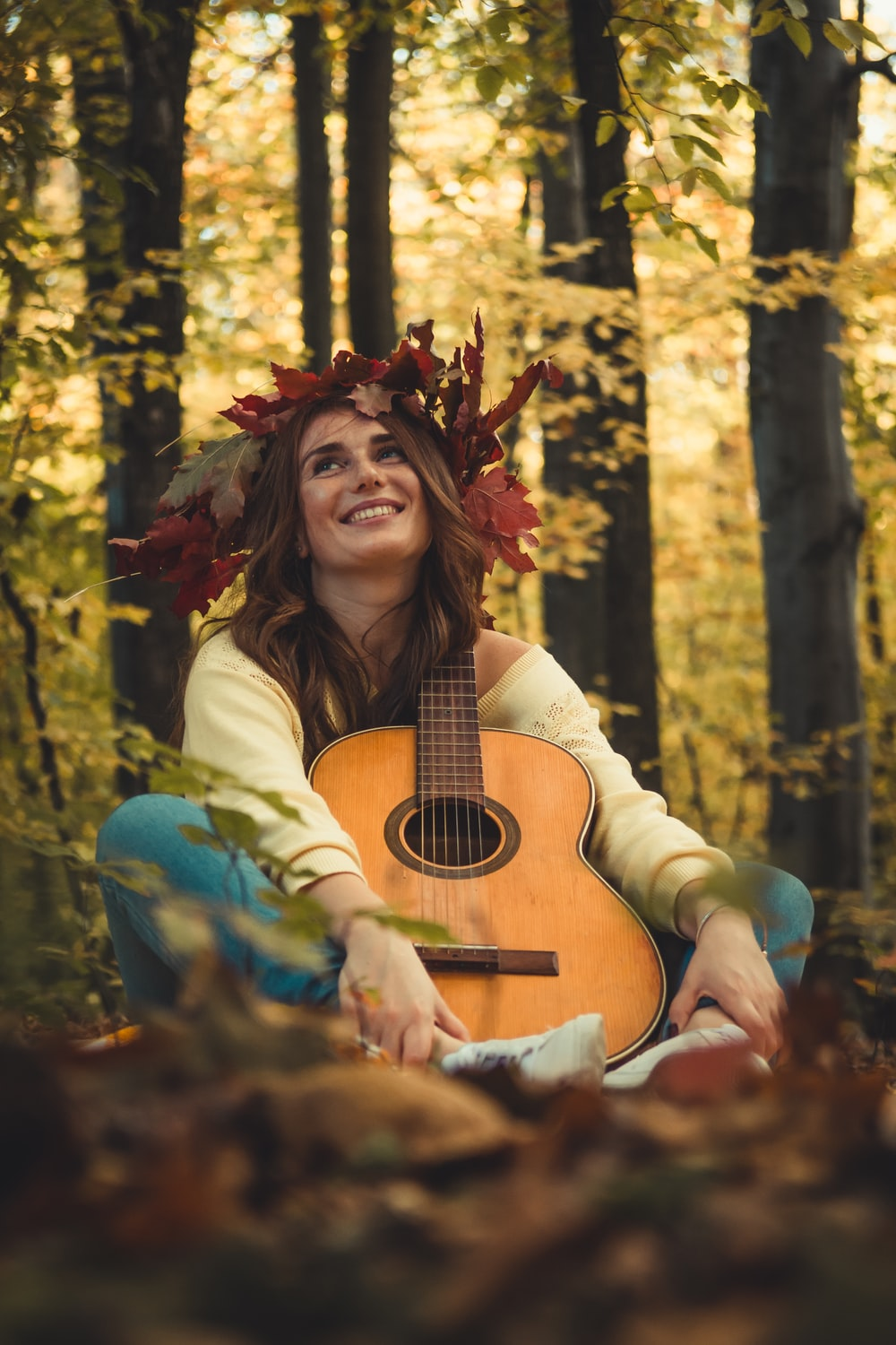 woman with guitar in forest