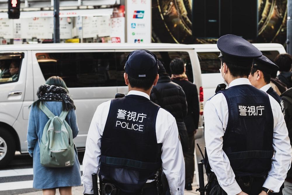 people standing beside street