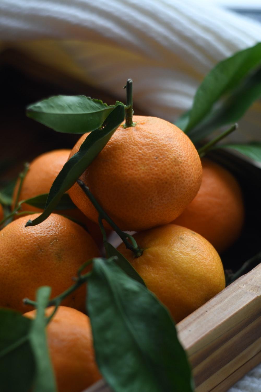 orange fruit on brown wooden tray