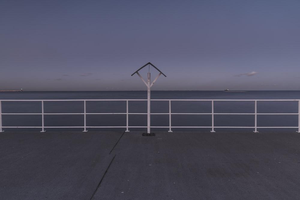 grya and white wooden boardwalk scenery