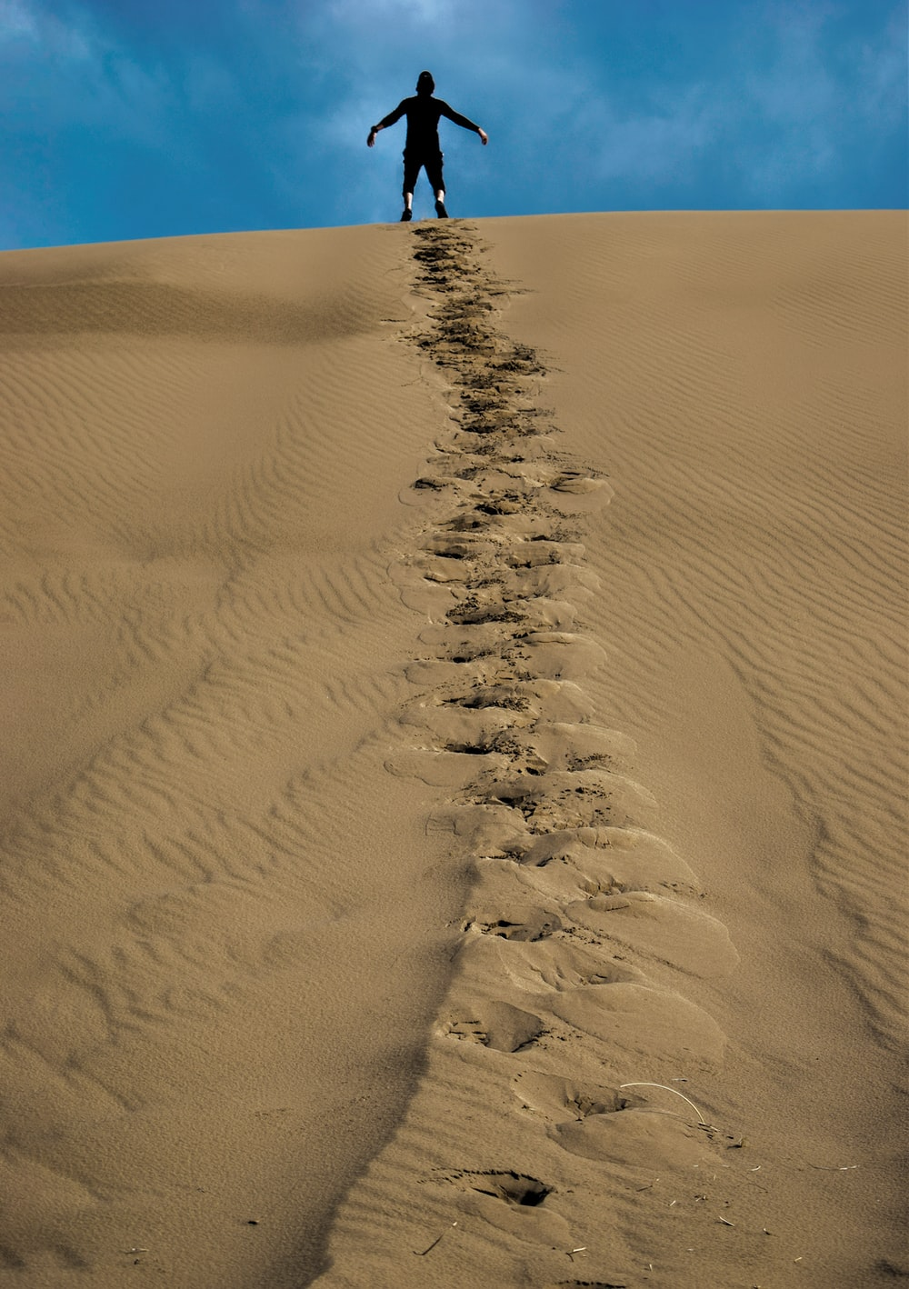 man on sand hill