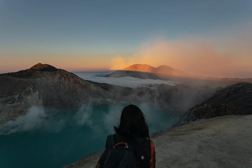 woman standing beside lake