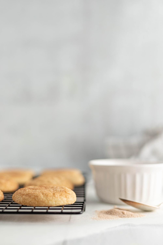 pastries on tray near white ceramic bowl