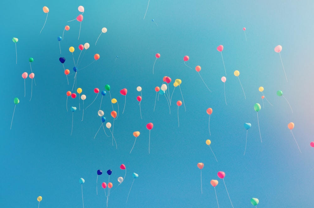 assorted colored balloons mid airs