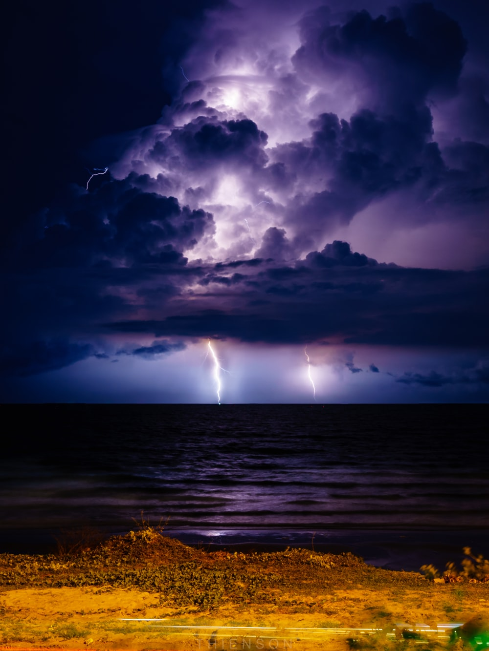 purple sky with clouds and lightning