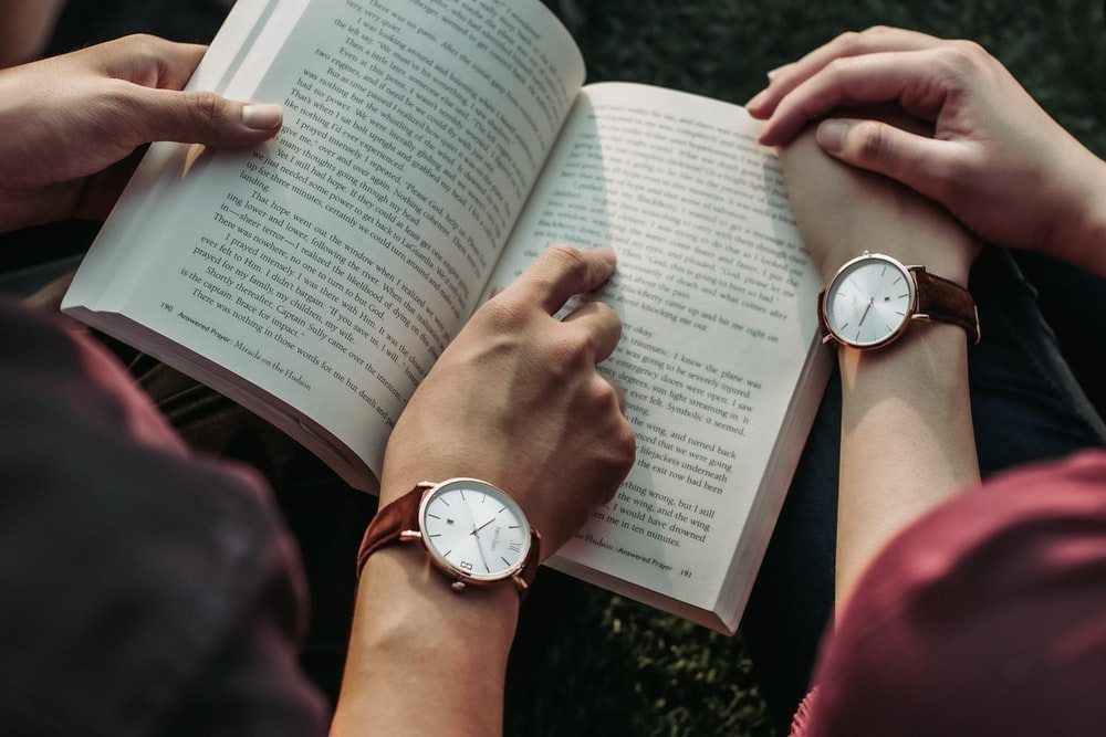 two people reading book