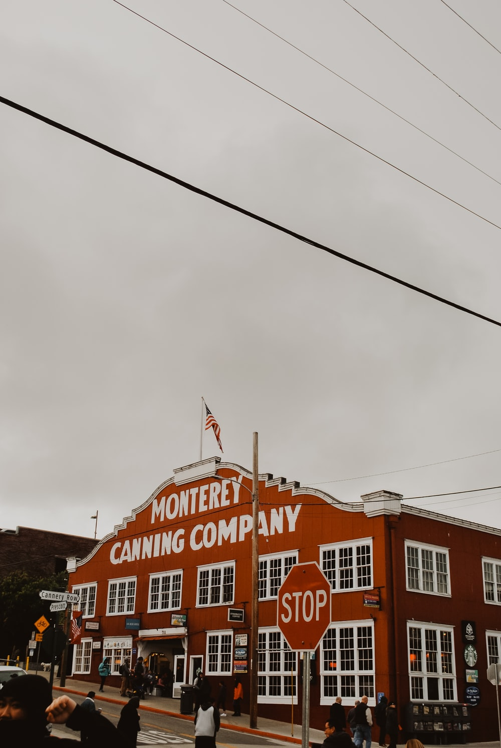 people walking near Monterey canning company building during daytime