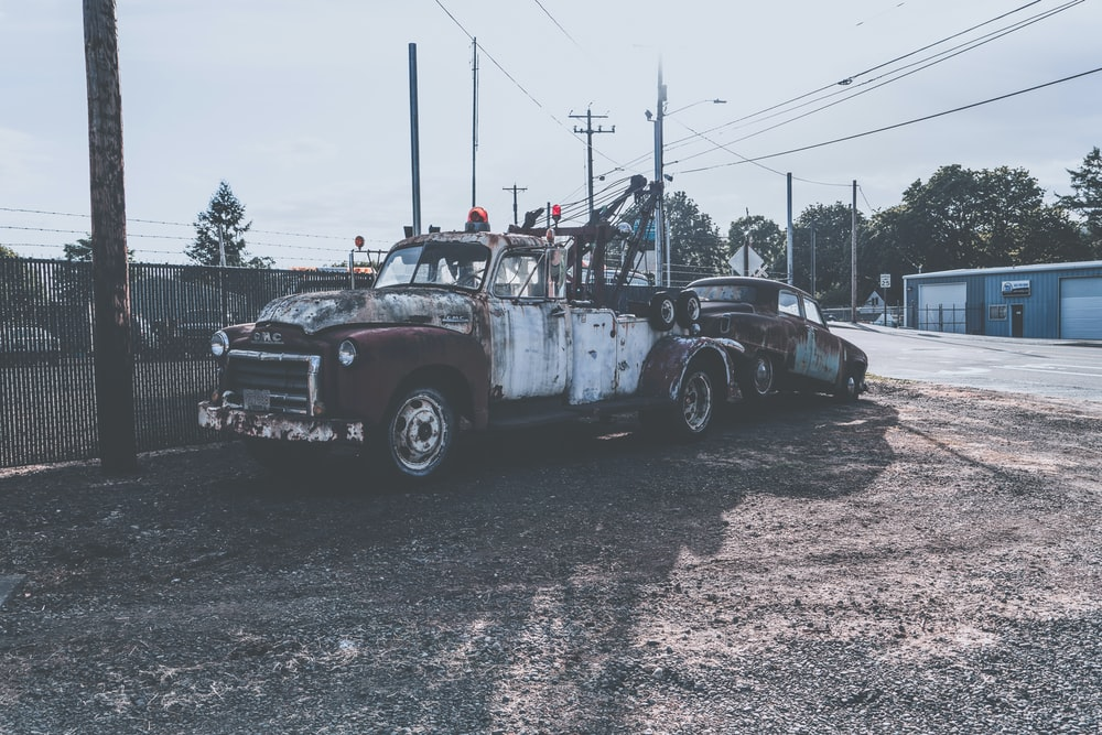 view photography of vehicle near electric post