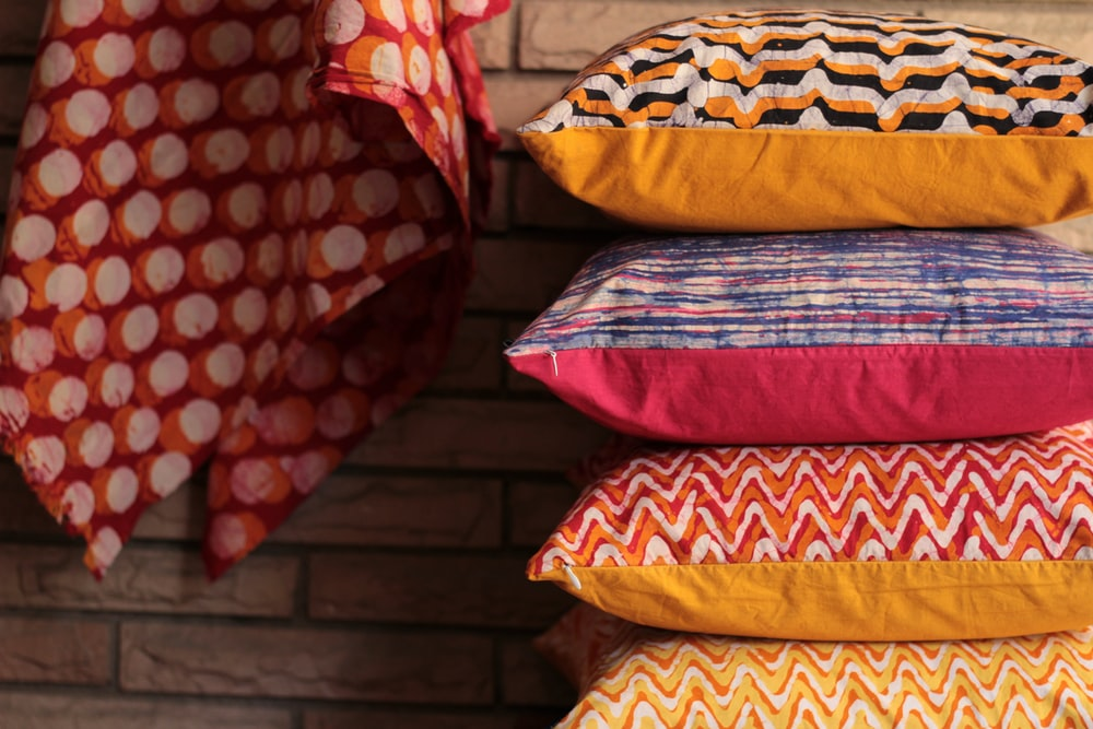 assorted-color stack of pillows