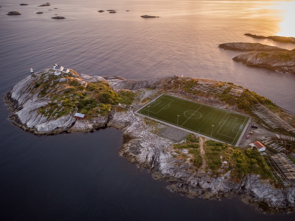 aerial photography of soccer field on island