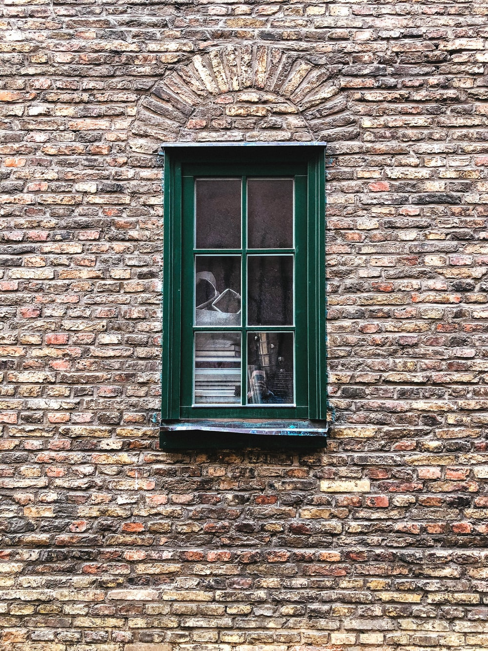 photo of green glass panel window