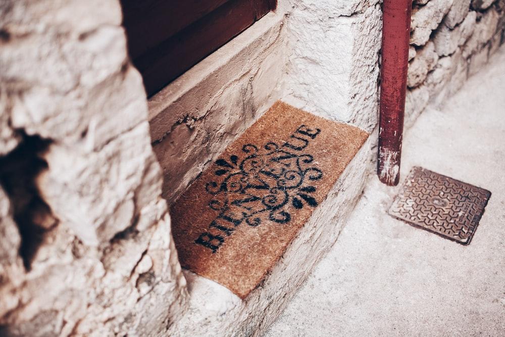 brown and balck door rug