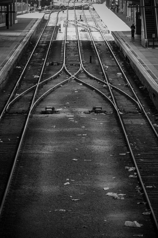 grayscale photography of empty railway