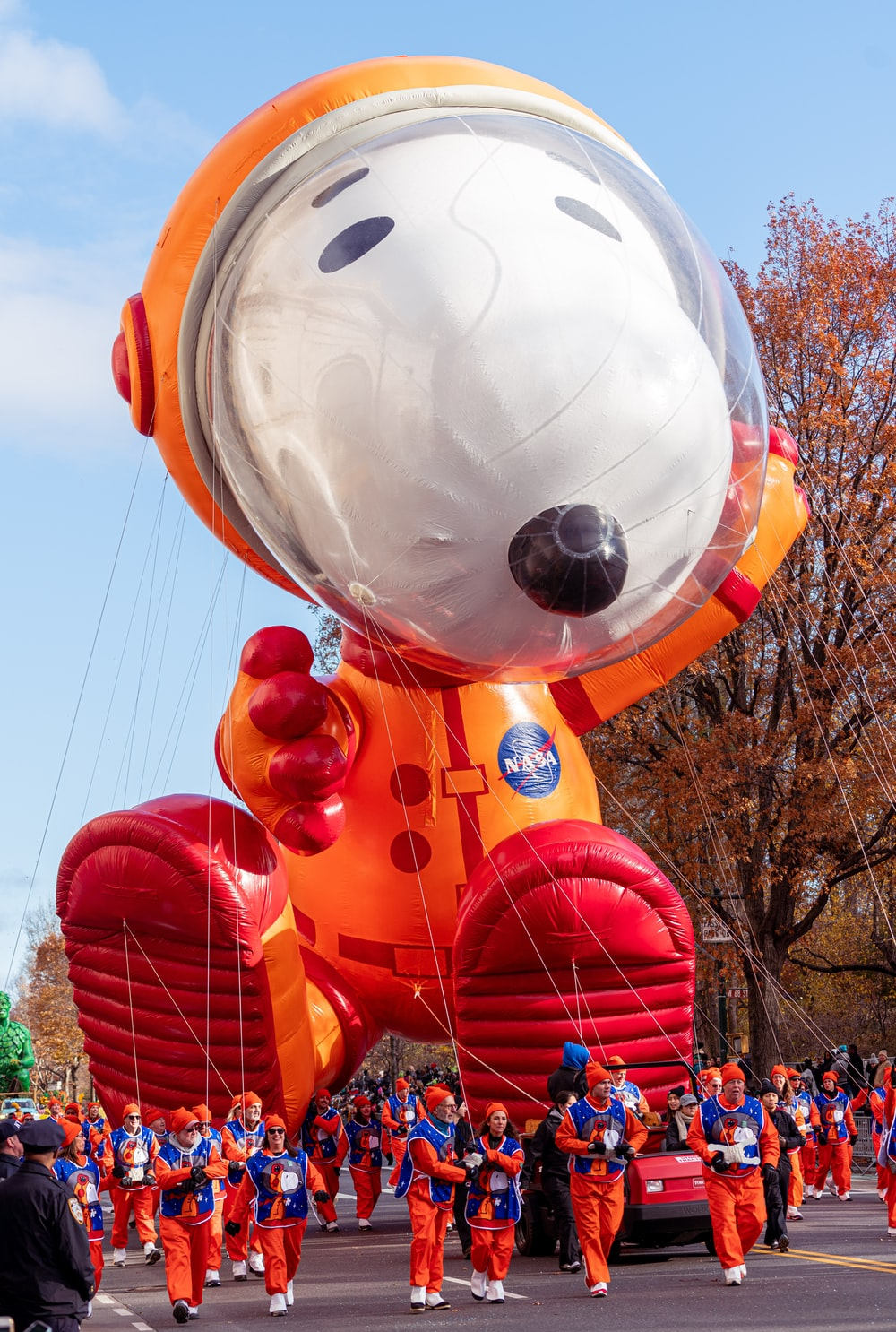 people pulling snoopy inflatable