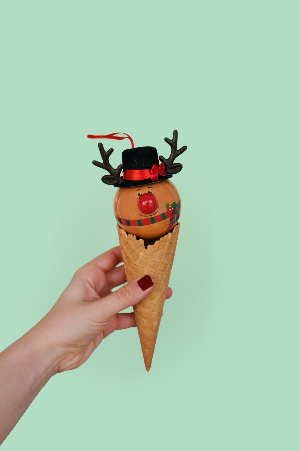 person holding cone with scarecrow