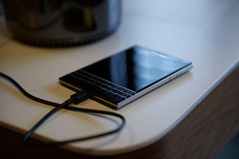 black Blackberry Passport on white tbale