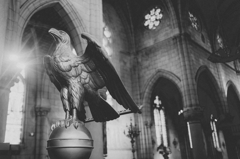 grayscale photo of American bald eagle statue