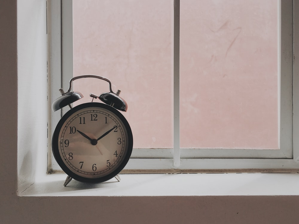 black alarm clock at 10:09