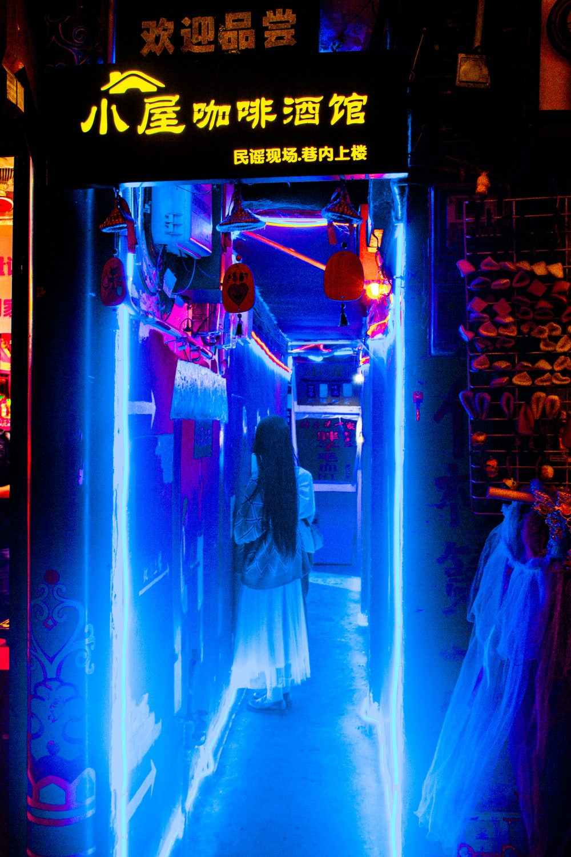 woman inside LED tunnel