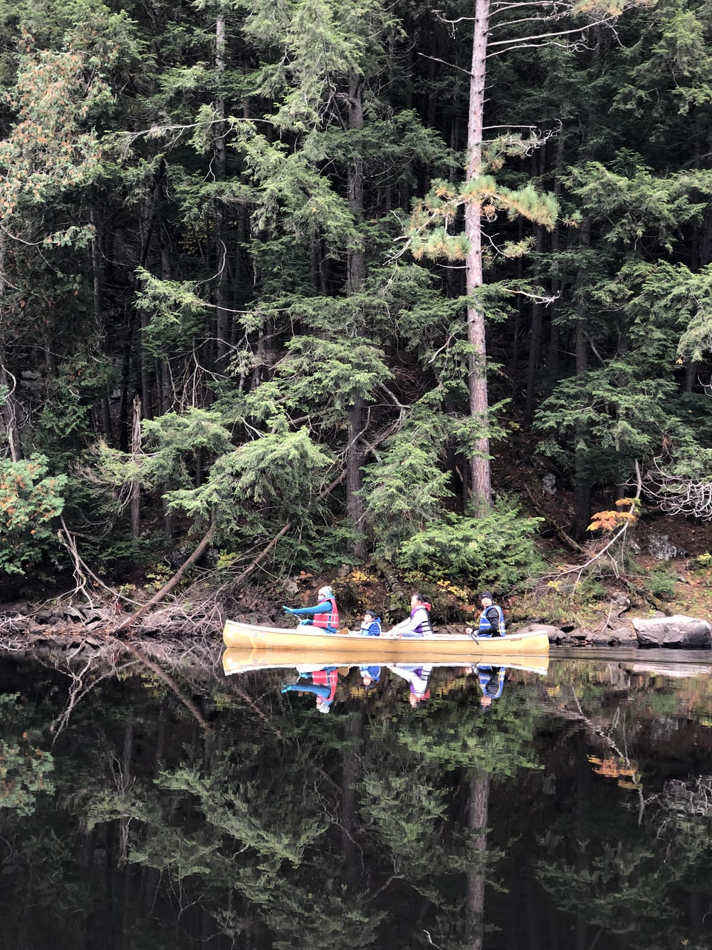 shallow focus photo of people riding boat on body of water