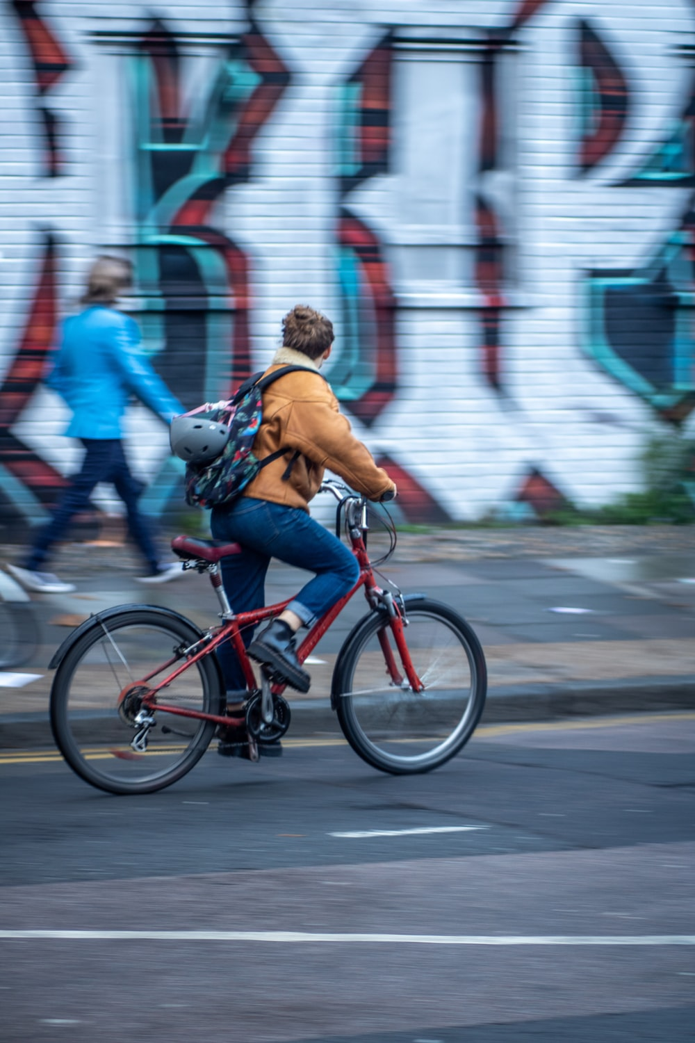 panning photography of person on bike