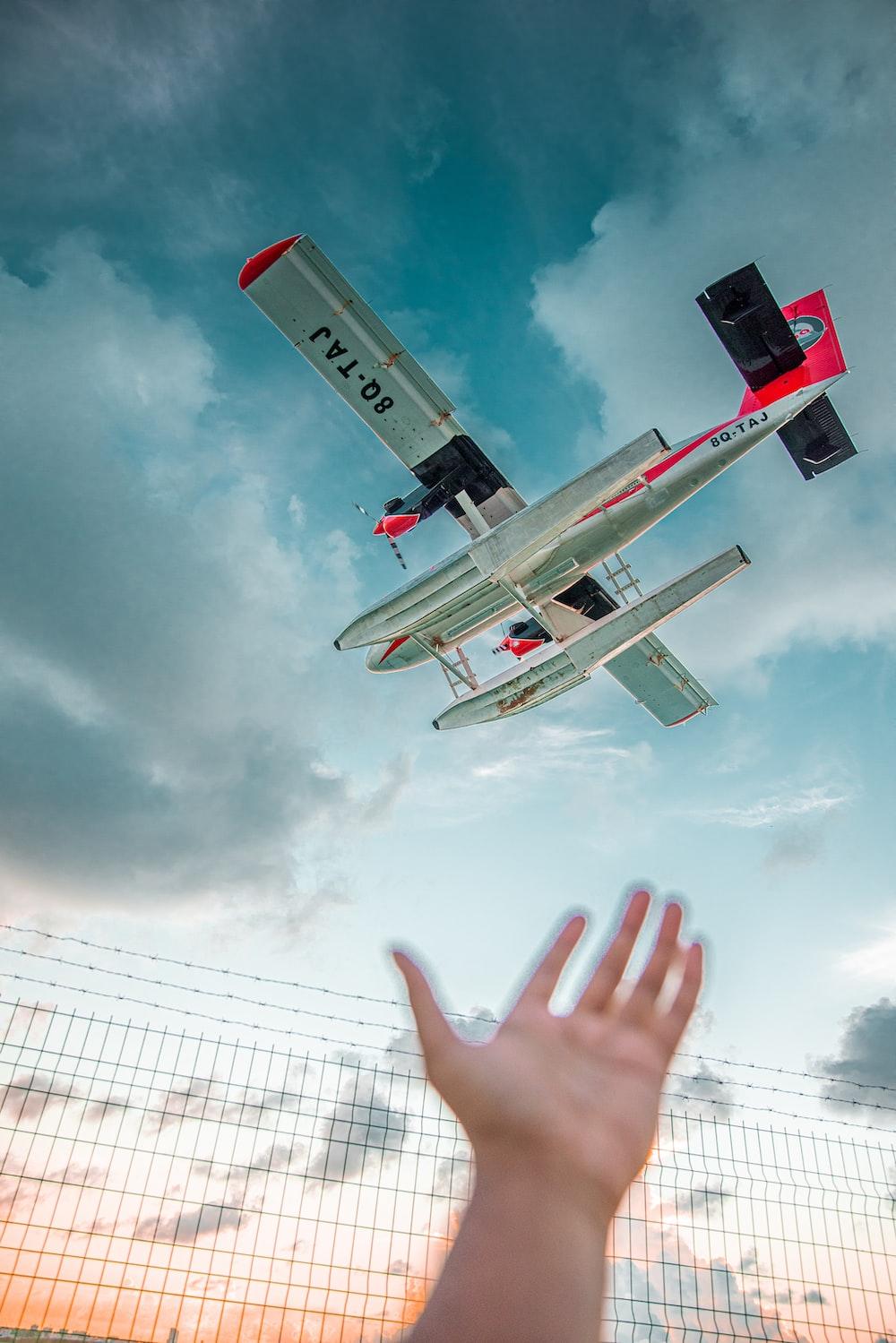 white monoplane on mid air