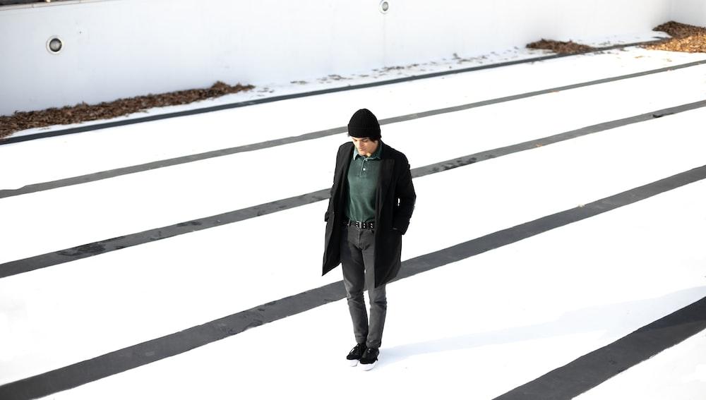 man in black coat