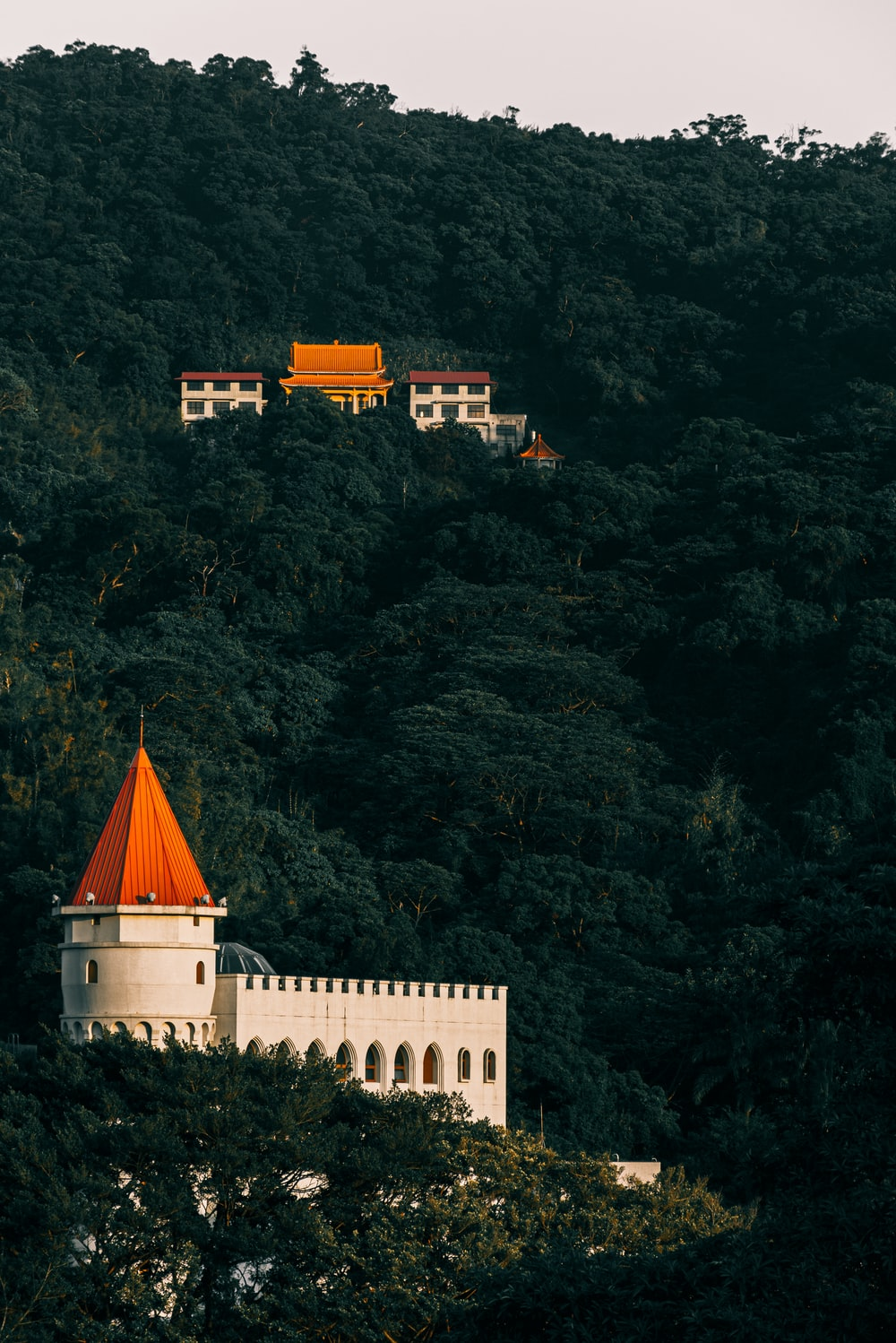white and orange castle on hills
