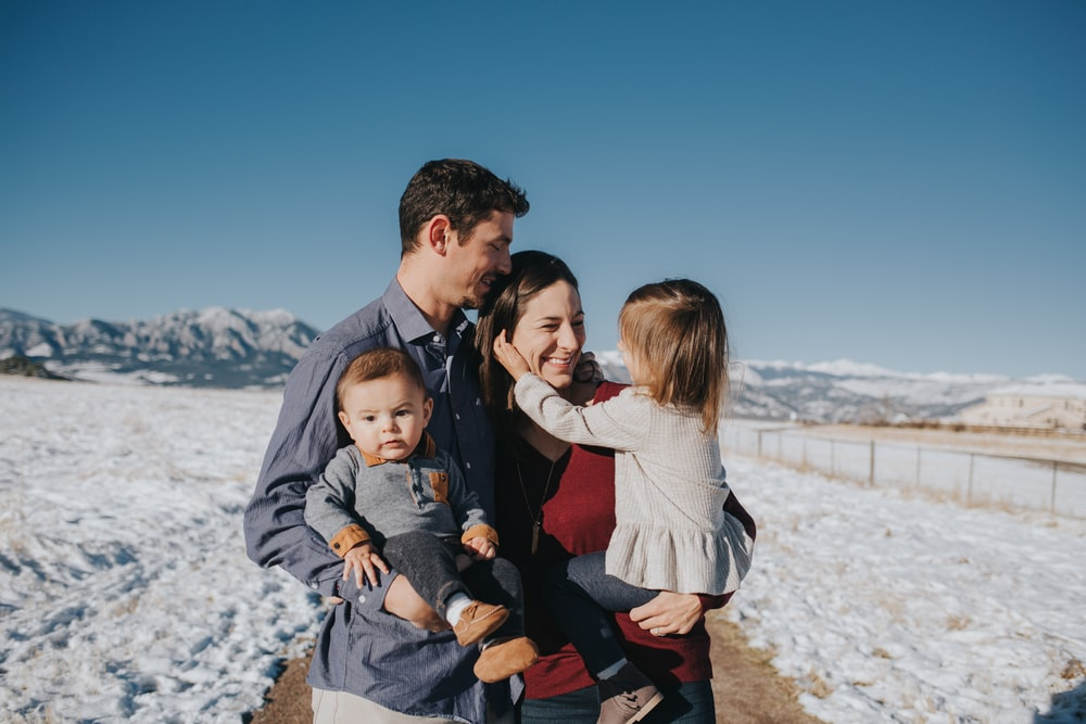 family on snow field