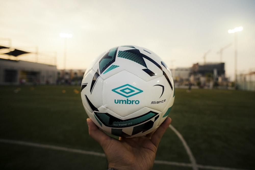 white and green Umbro soccer