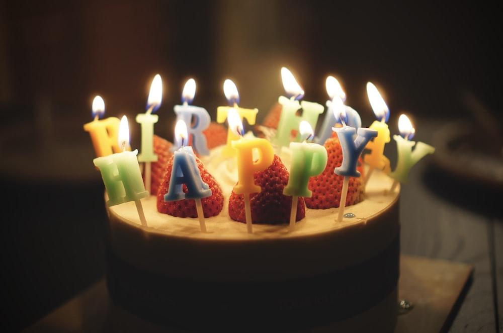 Baked Cake With Happy Birthday Candles On Top Photo Free Cake Image On Unsplash