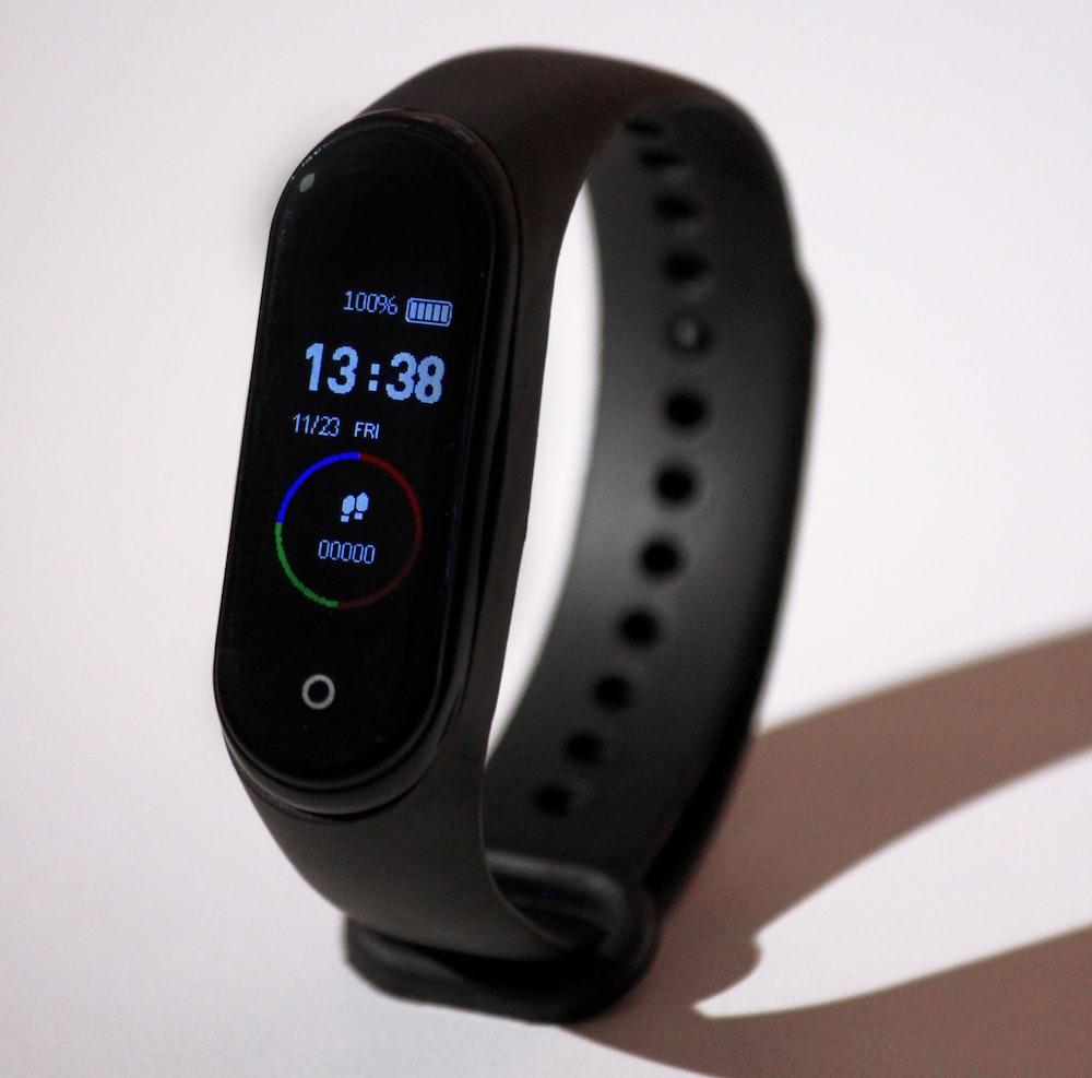 turned-on black LED watch