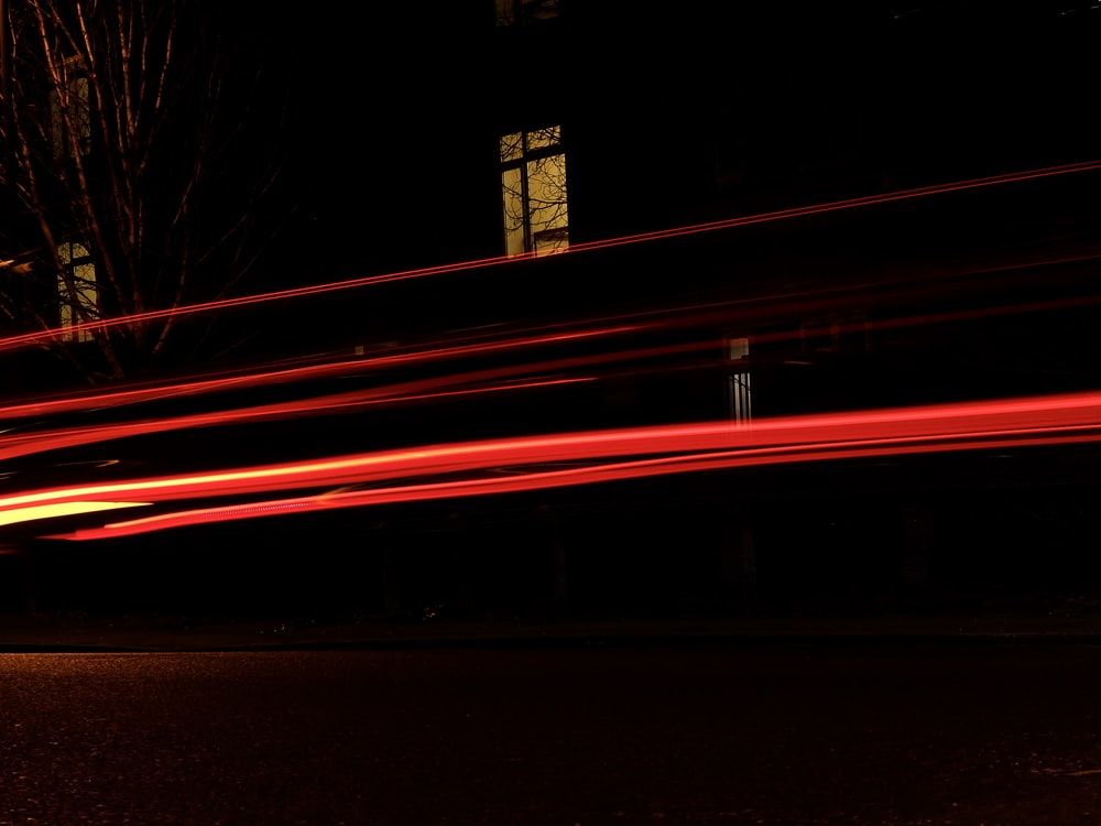 time lapse photography of vehicle passing by the street