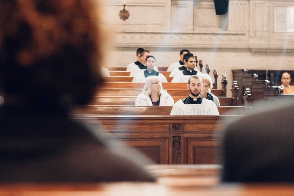 people sitting inside church building