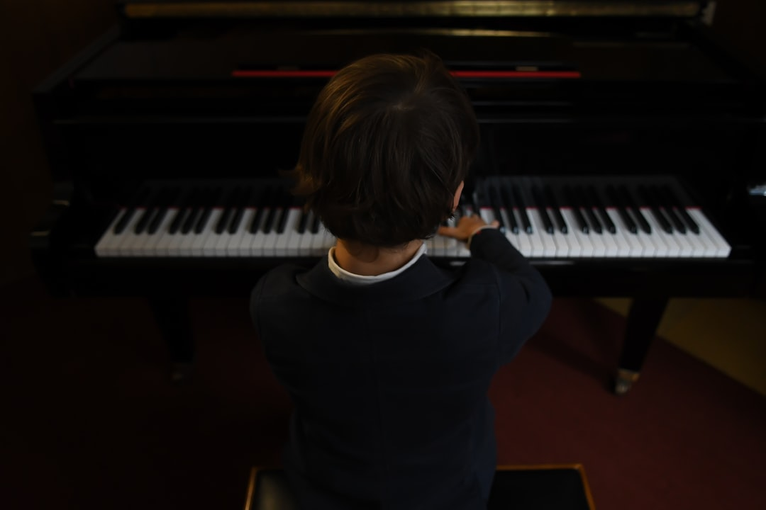 boy during a warm-up before a piano concert