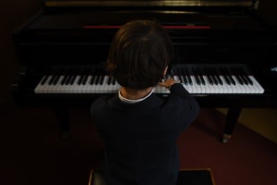 boy playing a piano