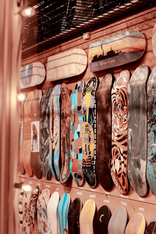 assorted-color skateboard decks displayed on wall