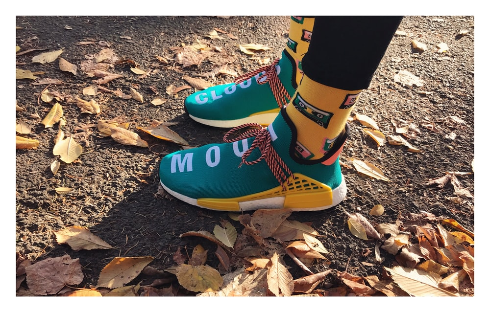 pair of green-and-yellow running shoes