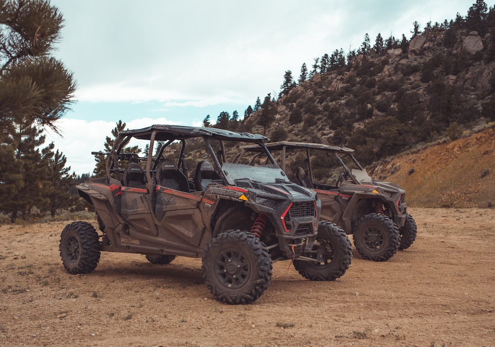two black-and-red UTV's