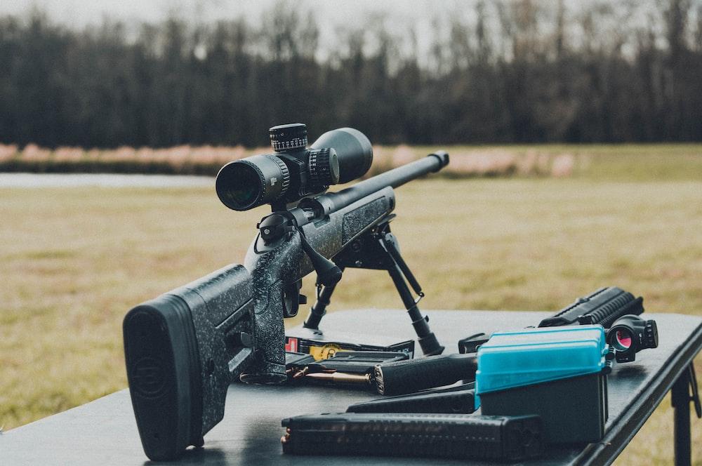 black rifle on table