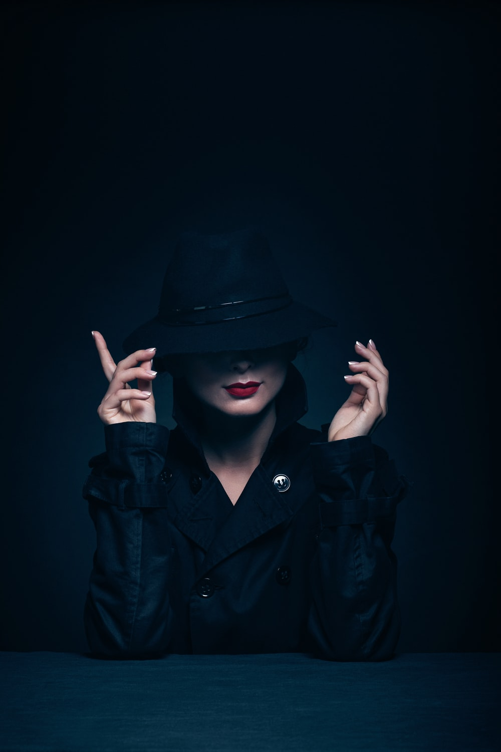 woman in black coat and hat