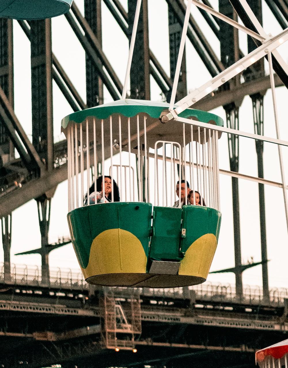 three person riding Ferris wheel