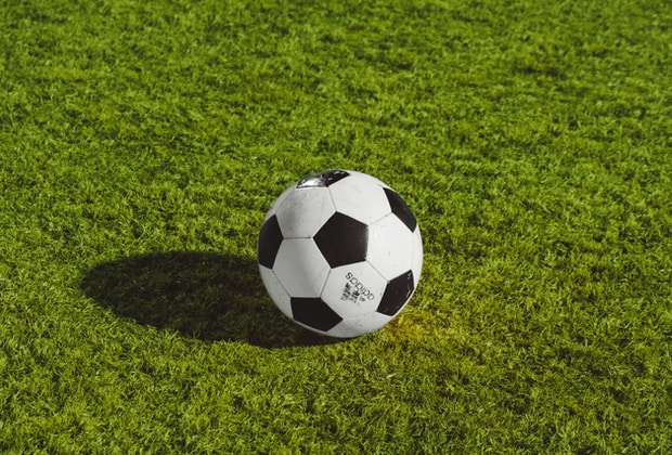 Monmouth, white and black soccer ball on grass field