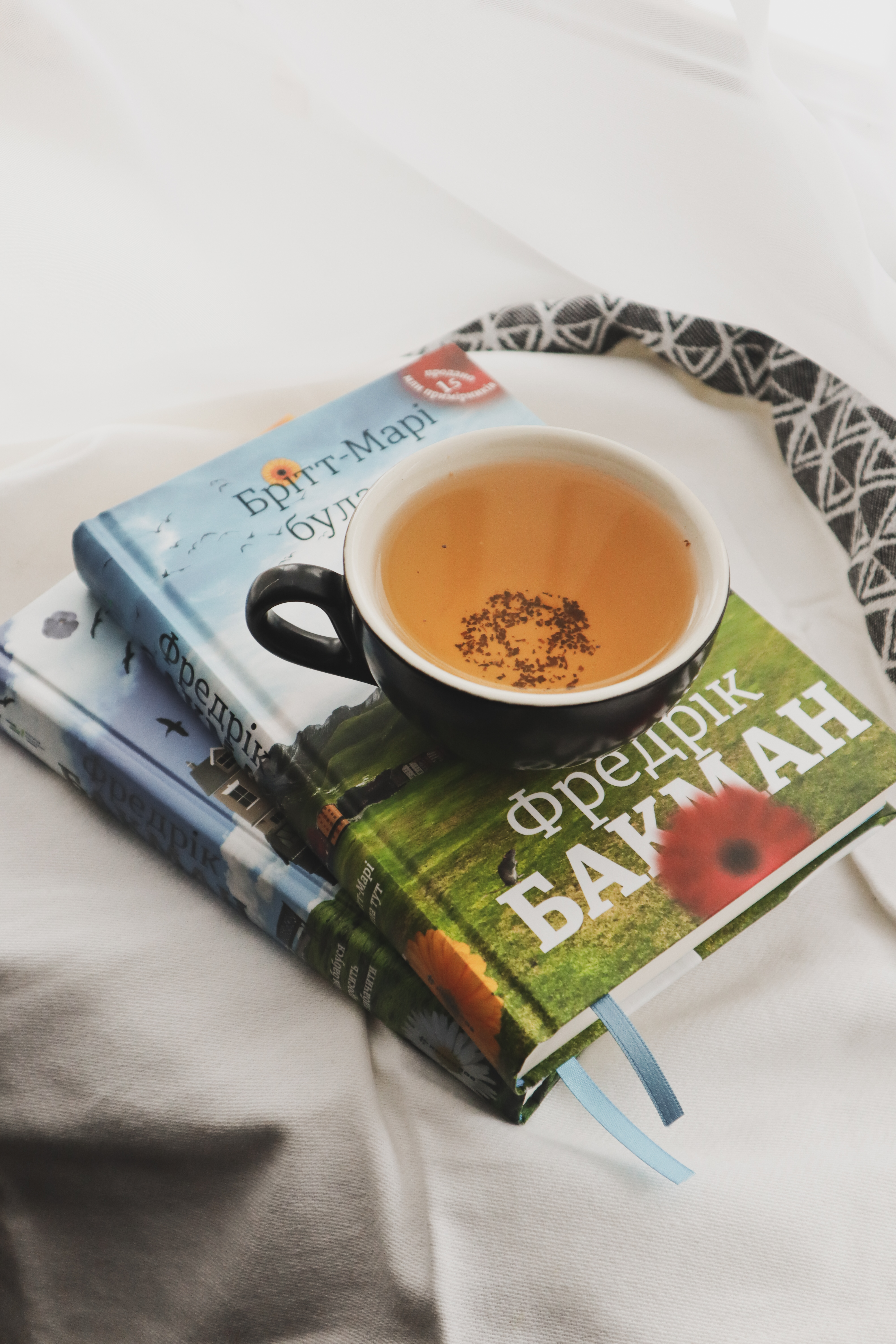 tea in a cup sitting on top of books