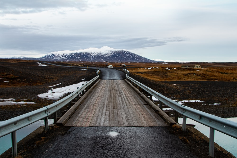 landscape photography of a winding road leading to a mountain
