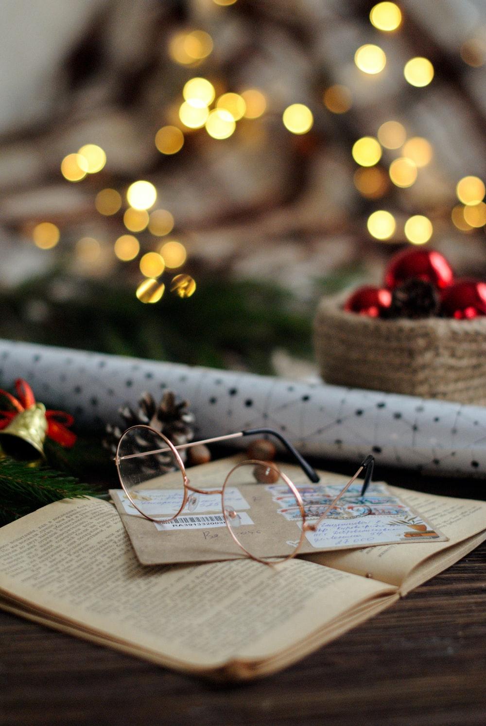 hippie eyeglasses on brown book