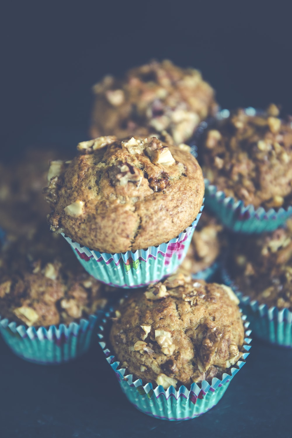 selective focus photo of pile of muffins